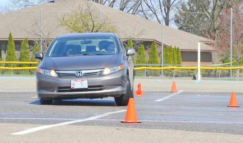 Alia Sater, 15, from Columbus, OH, navigates a fast pace skid control exercise, and plows over some cones, at a TireRack.com Street Survival School event at Boardman Park on Sunday, April 29, 2018.    Photo by Scott R. Williams - The Vindicator