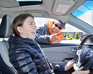 Hayley Ward, 17, from Mars, PA, is about to give Vindicator photographer Scott Williams and reporter Graig Graziosi a ride for their lives around a fast pace skid control exercise at a TireRack.com Street Survival School event at Boardman Park on Sunday, April 29, 2018.  Gregory Alley, from Uniontown, OH, an instructor at the event, gives Ward some last minute reminders.   