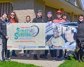 Participants of a TireRack.com Street Survival School take a class photo at the end of their event at Boardman Park on Sunday, April 29, 2018.  From left to right, they are Hayley Ward, Mars, PA; Liam Martin, Canfield, OH; Alia Sater, Columbus, OH; Brandon Carryer, Pittsburgh; Nic Mahan, Warren, OH; Kyle Kashbienski, Elyria, OH; Dillon Burnside, Kensington, OH; and Wendy Setterberg, Masury, OH.   Photo by Scott R. Williams - The Vindicator