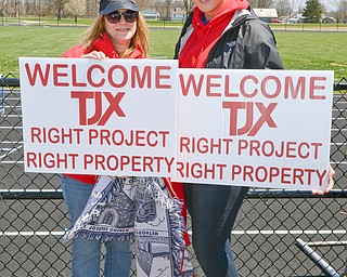 Donna Cowie, left, and Hanna Lutz display their pro TJX signs at a rally to keep TJX in the Mahoning Valley on Sunday, April 29, 2018 at the Lordstown High School track.  