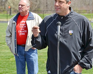 "Congressman Tim Ryan, right, addresses a packed set of bleachers at a rally to keep TJX in the Mahoning Valley on Sunday, April 29, 2018 at the Lordstown High School track. In the back, wearing his ""Keep Calm and Create Jobs"" teeshirt is Lordstown Mayor Arno Hill. 