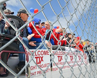 Attendees of a rally to Keep TJX in the Mahoning Valley showed their support with balloons and signs, cheering on the speakers on Sunday, April 29, 2018 at the Lordstown High School track.  