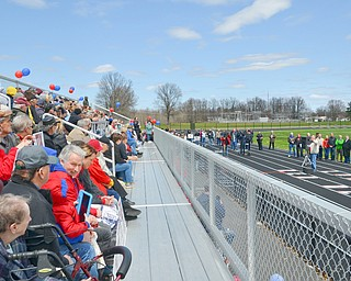 Lordstown Mayor Arno Hill (right) addresses a packed set of bleachers at a rally to keep TJX in the Mahoning Valley on Sunday, April 29, 2018 at the Lordstown High School track.  