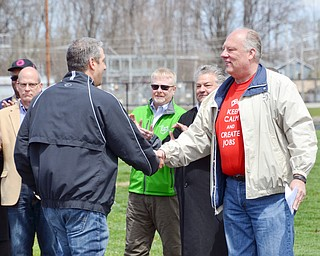 Lordstown Mayor Arno Hill, right, shakes the hand of Congressman Tim Ryan, thanking him for his support at a rally to keep TJX in the Mahoning Valley on Sunday, April 29, 2018 at the Lordstown High School track. 