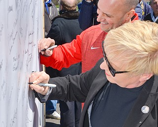Democratic candidate for governor of Ohio, Joe Schiavoni (left) and Republican candidate for Trumbull County commissioner Mary Williams sign their name to a banner in support of TJX at a rally to keep TJX in the Mahoning Valley on Sunday, April 29, 2018 at the Lordstown High School track.  