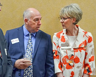 Ohio Supreme Court Justice Mary DeGenaro, right, chats with Barry Miner from Columbiana Country prior to the start of the Mahoning County Republican Party's Annual Abraham Lincoln Day Dinner held at The Maronite Center on Tuesday, May 1, 2018.    Photo by Scott Williams - The Vindicator