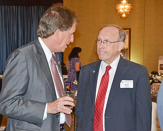 Mark Munroe, Mahoning County Republican Party chairman, (right) chats with Jim Renacci, U.S. Rep. Ohio 16th district, prior to the start of the Mahoning County Republican Party's Annual Abraham Lincoln Day Dinner held at The Maronite Center on Tuesday, May 1, 2018.    Photo by Scott Williams - The Vindicator
