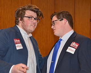 Young Republicans Tex Fischer, left, and Nick Cocca share a moment  prior to the start of the Mahoning County Republican Party's Annual Abraham Lincoln Day Dinner held at The Maronite Center on Tuesday, May 1, 2018.    Photo by Scott Williams - The Vindicator
