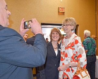 Steve DeGenaro takes a photo of his wife, Ohio Supreme Court Justice Mary DeGenaro (right) and Kathleen Bartlett, 7th District Court of Appeals, prior to the start of the Mahoning County Republican Party's Annual Abraham Lincoln Day Dinner held at The Maronite Center on Tuesday, May 1, 2018.  