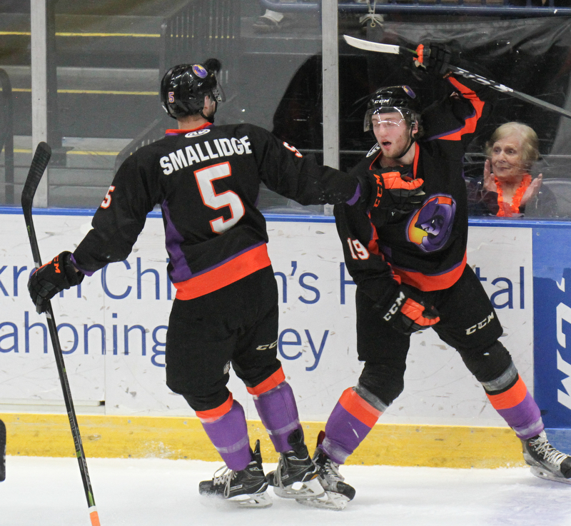 William D. Lewis The Vindicator Phantoms( Chase Grescock(19) gets congrats from Jason Smallidge(5) after scoring during 1rst period action 5-5-18 at Covelli.