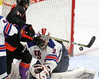 William D. Lewis The Vindicator Phantoms Samuel Salonen(71) shoots of USA goalie Cameron Rowe(31).