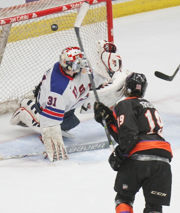 Chase Gresock (19) scores one of his record-breaking four goals against Team USA goaltender Cameron Rowe (31) Friday at the Covelli Centre. The Phantoms won 7-5 for a 2-1 series lead in the USHL's Eastern Conference Finals.