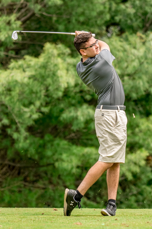THE VINDICATOR | DIANNA OATRIDGEÊ Alex Rapp, 17, of Poland, hits his second shot on Hole No. 3 at Pine Lakes Golf Club during the first qualifying round of the Greatest Golfer of the Valley competition on Sunday..