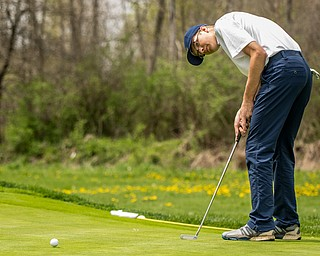 THE VINDICATOR | DIANNA OATRIDGEÊ Justin Atkinson, 16, of Brookfield, makes a putt onto the green on Hole No. 6 during Sunday's Greatest Golfer of the Valley qualifier at Pine Lakes Golf Club in Hubbard..