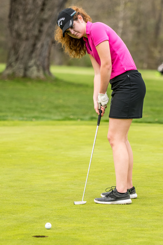THE VINDICATOR | DIANNA OATRIDGEÊ Canfield's Eileen McHale sinks her putt on the No. 7 green at Pine Lakes Golf Club in Hubbard on Sunday's Greatest Golfer of the Valley qualifying round..