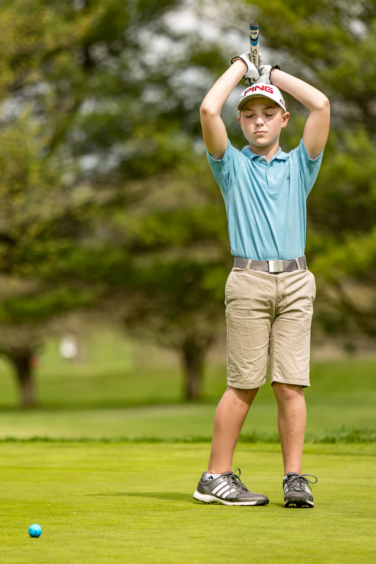 THE VINDICATOR | DIANNA OATRIDGEÊ Anthony Cisaro, 11, of Niles, reacts after leaving his putt short on the No. 7 green at Pine Lakes Golf Club in Hubbard on Sunday during the Greatest Golfer of the Valley qualifier.