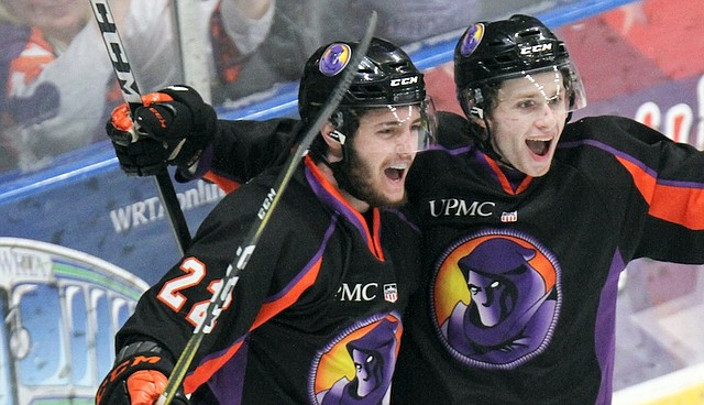 Phantoms forward Dalton Messina (22) is congratulated by linemate Max Ellis after tying Team USA 1-1 in the first period Saturday at the Covelli Centre. It was the first of five goals as the Phantoms clinched the USHL's Eastern Conference for the first time.