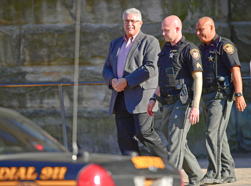 WARREN, OHIO - MAY 7, 2018: Former Niles Mayor Ralph Infante is escorted, by Sheriffs deputies, out of the Trumbull County Courthouse to the Trumbull County Jail in handcuffs after being found guilty on twenty two charges, Monday night. DAVID DERMER | THE VINDICATOR