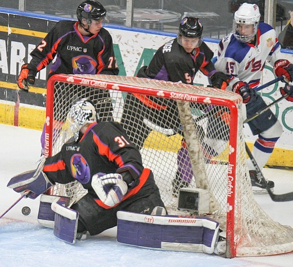Phantoms goalie Ivan Prosvetov (31) has a 6-1 record in the USHL's postseason. Behind the net in Saturday's 5-1 victory are Phantoms defensemen Liam Dennison (72) and Jason Smallidge (5) as well as Team USA's Usa's Ryder Rolston (45).