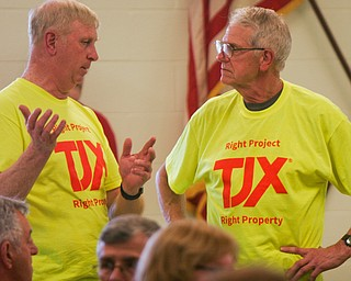 William D. Lewis The Vindicator Harvey Lutz, left, and Don Koches, both of Lordstown  and supporters of the TJX project, talk during a zoning meeting at the Lordstown Administration building Tuesday.