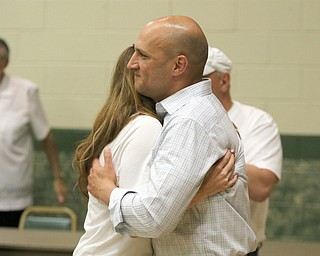 ROBERT K.YOSAY  | THE VINDICATOR..Joe gets a hug and a kiss from his wife margaret after he spoke to supporters ..-30-