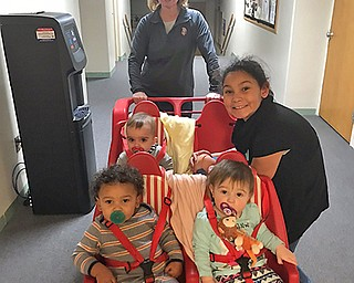 "Elizabeth Morar has reared three ""crazy"" kids at home, according to her daughter, Alexandra Morar, who submitted this photo of Elizabeth and some of the youngsters at the day care center she has operated for the past 13 years."