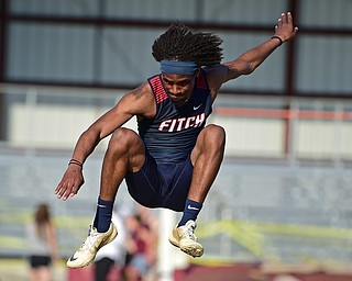 BOARDMAN, OHIO - MAY 8, 2018: Fitch's Deondre McKeever flies through the air during the boy high jump during the AAC Red Tier Track Championship at Boardman High School, Tuesday night. DAVID DERMER | THE VINDICATOR