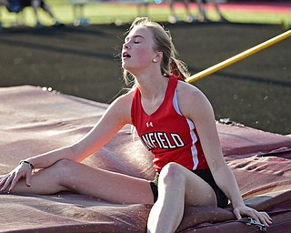 BOARDMAN, OHIO - MAY 8, 2018: Canfield's Morgan Schneider shows her frustration after knocking the bar off during the girls high jump during the AAC Red Tier Track Championship at Boardman High School, Tuesday night. DAVID DERMER | THE VINDICATOR