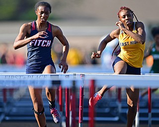 BOARDMAN, OHIO - MAY 8, 2018: Fitch's Khala Cameron and East's DeShante Allen race during their heat of the girls 100 meter hurdles during the AAC Red Tier Track Championship at Boardman High School, Tuesday night. DAVID DERMER | THE VINDICATOR