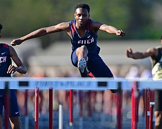 BOARDMAN, OHIO - MAY 8, 2018: Fitch's Reggie Floyd races to the finish line ahead of Fitch's Kyle Long and Harding's Emarion Perkins during the boys 110 meter hurdles during the AAC Red Tier Track Championship at Boardman High School, Tuesday night. DAVID DERMER | THE VINDICATOR