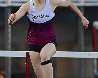 BOARDMAN, OHIO - MAY 8, 2018: Boardman's Raegan Burkey clears the last hurdle before crossing the finish line in the girls 300 meter hurdles during the AAC Red Tier Track Championship at Boardman High School, Tuesday night. DAVID DERMER | THE VINDICATOR