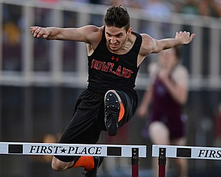 BOARDMAN, OHIO - MAY 8, 2018: Howland's Jonny Elliot clears a hurdle during the boys 300 meter hurdles during the AAC Red Tier Track Championship at Boardman High School, Tuesday night. DAVID DERMER | THE VINDICATOR