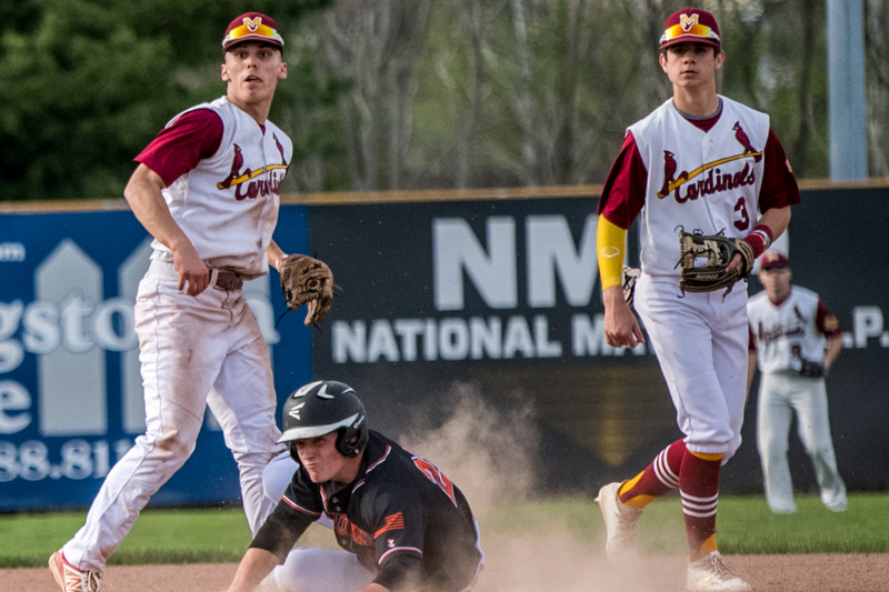 THE VINDICATOR | DIANNA OATRIDGEÊ ÊHowland's Hayden Parker (center) is called out at second base on the front end of a double play attempt and looks to first base with Cardinal Mooney's John Mikos (left) and Ethan Shaw (right) for the call during Division II Sectional Final play at Cene Park on Wednesday. The Cardinals won the game 11-2.