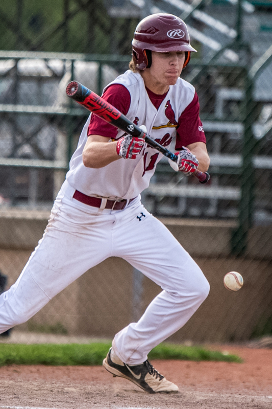 THE VINDICATOR | DIANNA OATRIDGEÊ Cardinal Mooney's Brandon Mikos lays down a bunt during their 11-2 win over Howland in the Division II Sectional Final at Cene Park on Wednesday.