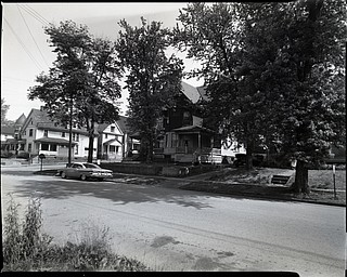 "89.119 B2F61 N.   View looking North-West along Lincoln Avenue toward Fifth Avenue, Hotel West later Hotel Allison with tower, Home of Mr. and Mrs. George Adams, later rooming house, rooming house on NE corner double house;.1963. Archives, original negative is 4"" x 5"" black and white. Digital image is 800 dpi RGB."