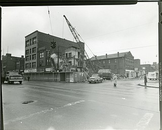"89.119 B3F6 Photographic print of the view looking north toward the corner of E. Federal Street and Watt Street. Clearance for the Downtown Loop.  Boardman Hotel, Superior Chemical Products Co., Salvation Army Citadel are on the right. SS. Cyril & Methodious Roman Catholic Church is on left in the background.  Demolition of Pesas Wallpaper & Paint, and Hume's Furniture. Same as B3F5. Archives, original print is 4"" x 5"" black and white. Digital image is 800 dpi RGB."