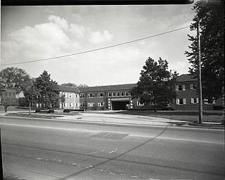 "89.119 B5F265 Negative of the portion of Youngstown State University Campus on Wick Avenue showing the Wick Avenue Motel, a.k.a. Valley Park Hotel (demolished in 1970s). Archives, original negative is 4"" x 5"" black and white. Digital image is 800 dpi RGB."