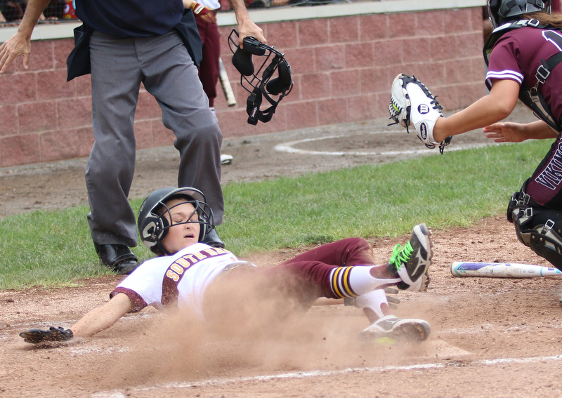 Maddie Helon (2) of South Range falls into home plate after being tagged in the mask by Waterloo catcher Amber Cieplinski (17) during their semi finals matchup on Monday night. Dustin Livesay  |  The Vindicator  5/14/18  Canfield