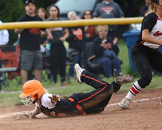 Makenzy Capouellez (4) of Springfield slides safely into third base beating the tag by Girard's Lorren Alejars (5) during Monday evenings semi-finals matchup at South Range High School.  Dustin Livesay  |  The Vindicator  5/14/18  South Range High School, Canfield.