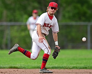 STRUTHERS, OHIO - MAY 15, 2018: Niles' Zach Leonard breaks on the ball which would be a base hit by Poland's Braeden O'Shaughnessy in the third inning of their OHSAA tournament game on Tuesday afternoon at Cene Park. Niles won 4-3. DAVID DERMER | THE VINDICATOR