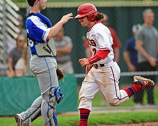 STRUTHERS, OHIO - MAY 15, 2018: Niles' Nick Guarnieri scores a run on a hit by David Mays in the third inning of their OHSAA tournament game on Tuesday afternoon at Cene Park. Niles won 4-3. DAVID DERMER | THE VINDICATOR..Poland MJ Farber pictured.