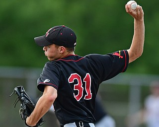 STRUTHERS, OHIO - MAY 15, 2018: Canfield starting pitcher Jack Rafoth delivers in the fifth inning of their OHSAA tournament game on Tuesday afternoon at Cene Park. Canfield won 4-3. DAVID DERMER | THE VINDICATOR