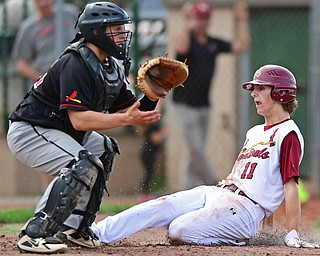 STRUTHERS, OHIO - MAY 15, 2018: Mooney's Brandon Mikos slides across home plate to score a run on a hit by John Mikos in the fifth inning of their OHSAA tournament game on Tuesday afternoon at Cene Park. Canfield won 4-3. DAVID DERMER | THE VINDICATOR..Canfield's Angelo Petraci pictured.