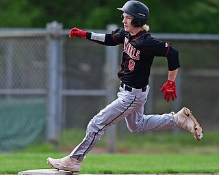 STRUTHERS, OHIO - MAY 15, 2018: Canfield's Dominic Pilolli steps on third base to complete a triple in the fifth inning of their OHSAA tournament game on Tuesday afternoon at Cene Park. Canfield won 4-3. DAVID DERMER   THE VINDICATOR