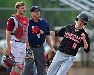 STRUTHERS, OHIO - MAY 15, 2018: Canfield's Dominic Pilolli scores a run on a hit by Spencer Woolley in the fifth inning of their OHSAA tournament game on Tuesday afternoon at Cene Park. Canfield won 4-3. DAVID DERMER | THE VINDICATOR..Mooney catcher Jake Fonderlin pictured.