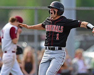 STRUTHERS, OHIO - MAY 15, 2018: Canfield's Anthony Longo celebrates after scoring a run on double by Ian McGraw in the fifth inning of their OHSAA tournament game on Tuesday afternoon at Cene Park. Canfield won 4-3. DAVID DERMER | THE VINDICATOR..Mooney relief pitcher Brandon Mikos pictured.