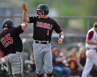 STRUTHERS, OHIO - MAY 15, 2018: Canfield's Anthony Longo, right, celebrates with Angelo Petracci after scoring a run on double by Ian McGraw in the fifth inning of their OHSAA tournament game on Tuesday afternoon at Cene Park. Canfield won 4-3. DAVID DERMER | THE VINDICATOR..Mooney relief pitcher Brandon Mikos pictured.