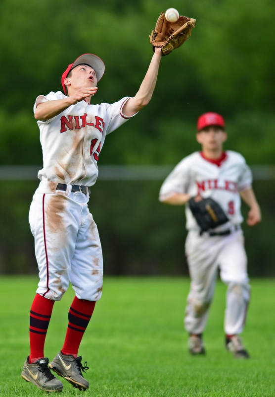 STRUTHERS, OHIO - MAY 15, 2018: Niles' Luke Swauger catches a fly ball for the out in the seventh inning of their OHSAA tournament game on Tuesday afternoon at Cene Park. Niles won 4-3. DAVID DERMER | THE VINDICATOR