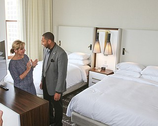 ROBERT K YOSAY  | THE VINDICATOR.. Terrill Vidale and Jackie Marchionda talk about one of the suites....Double Tree in Youngstown opened its restaurant and Hotel today Wed. in the former Stambaugh Building.  The building  has been restored to its original marble and granite and then some....-30-