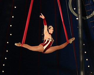 ROBERT K YOSAY  | THE VINDICATOR..Elena Sanders does acrobatic ribbon dance high up in the Big Top..The Zoppe Family Circus is returning to the Canfield Fairgrounds May 16-20 for 12 shows..Founded in 1842, the Zoppe Family Circus is a one-ring circus under the big top featuring acrobats, equestrian showmanship, canine tricks, clowns and plenty of audience participation. ...-30-